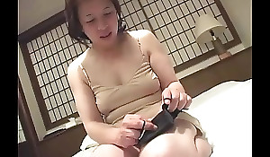 Asian granny inserts a sex tool hither her pussy
