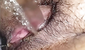 Hairy pussy babe taking a piss closeup