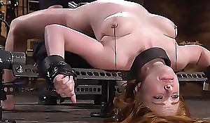 Blonde in extreme bondage devices toyed